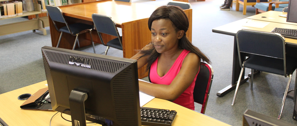 Student using a computer in the library